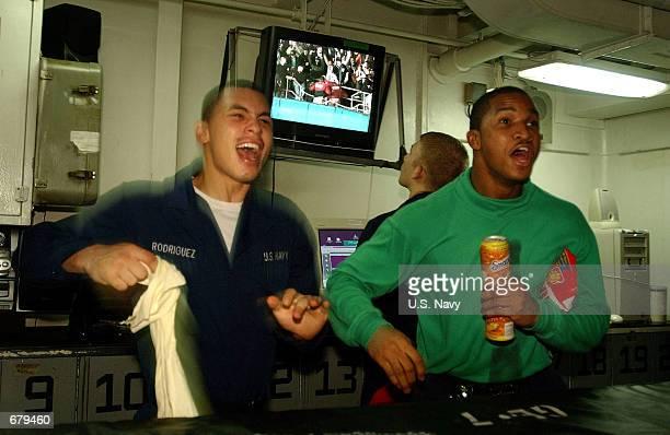New York City natives Seaman Rodriguez and Seaman Hamilton celebrate New York Yankee Derek Jeter's game-winning homerun in game four of the 2001...