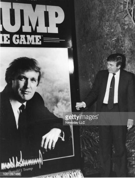 Donald Trump looks at a poster to promote Donald Trump The Game__a board game produced by Milton Bradley and introduced at the Atrium at Trump Tower...