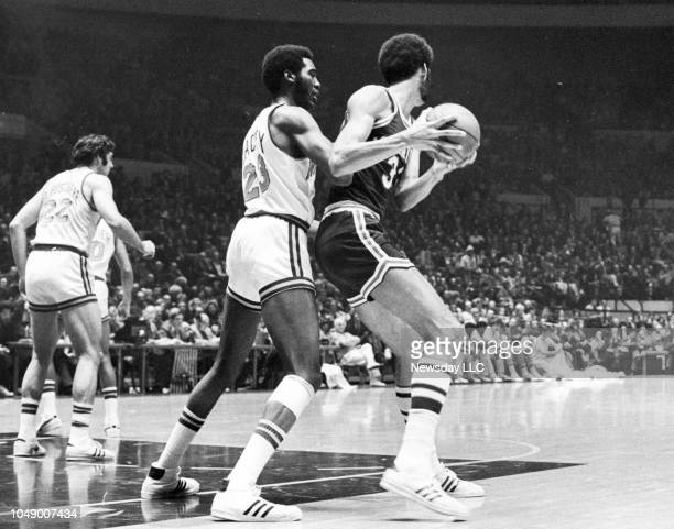 Luther Rackley of the Knicks guards Kareem AbdulJabbar of the Milwaukee Bucks during a game at Madison Square Garden in Manhattan New York on Jan 3...