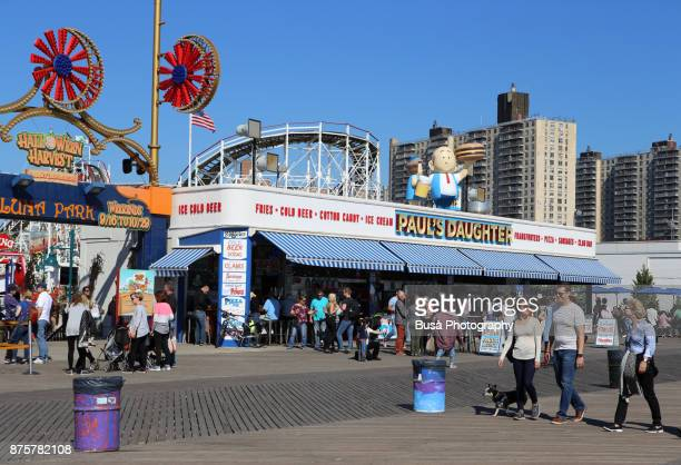 New York City, NY, USA - October 1st, 2017: People walking by the Famous Paul's Daughter restaurant along the boardwalk in Coney Island, Brooklyn