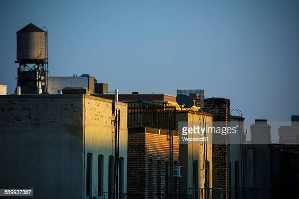 USA, New York City, Old water tanks on rooftops in East Village