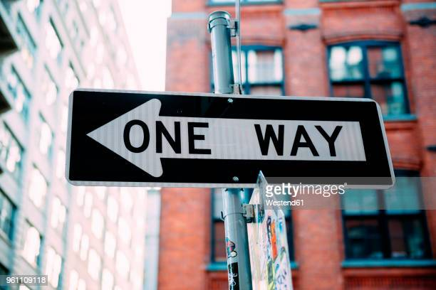 usa, new york city, one way sign - one direction stock pictures, royalty-free photos & images