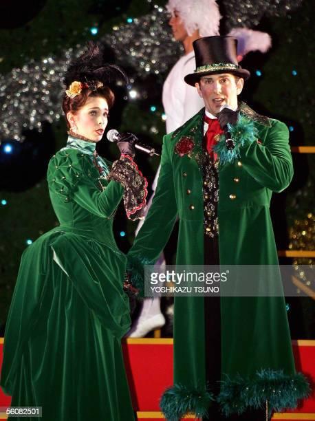New York City Opera tenor Brandon Wood and soprano Erin Stewart sing Christmas carols in front of Japan's largest 36metertall Christmas tree at...