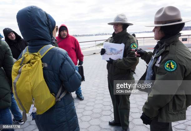 New York City Park Rangers Adriana Caminero and A Duran explain to wildlife enthusiasts the types of seals they'll be looking for March 10 2018 near...