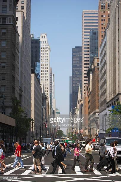 USA, New York City, people on pedestrian crossing in Midtown Manhattan