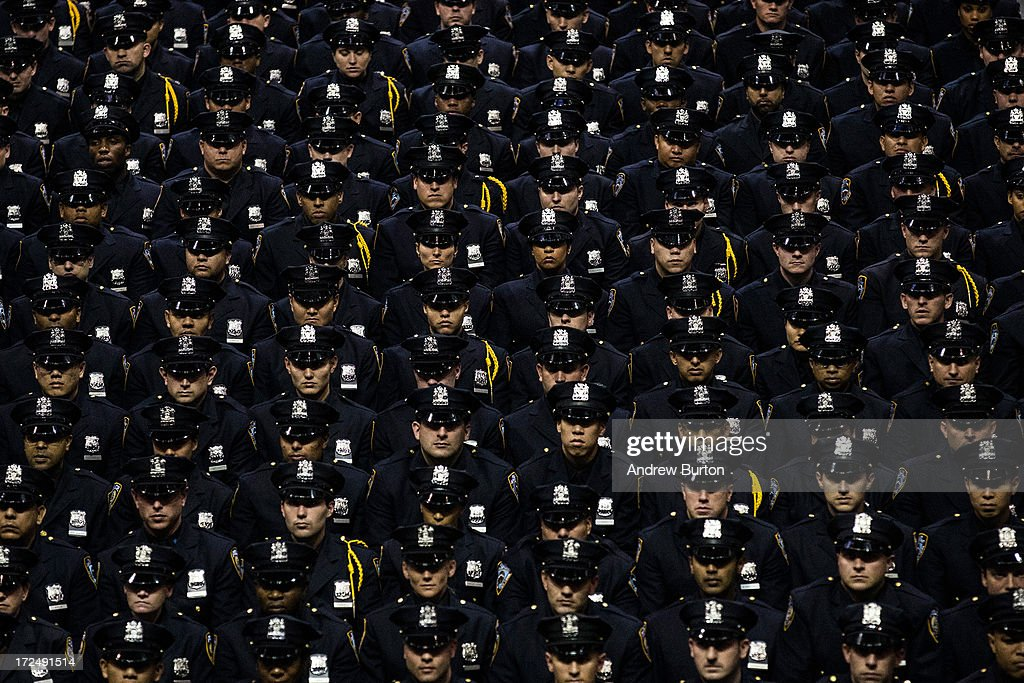 New York City Police Academy cadets attend their graduation ceremony at the Barclays Center on July 2, 2013 in the Brooklyn borough of New York City. The New York Police Department (NYPD) has more than 37,000 officers; 781 cadets graduated today.