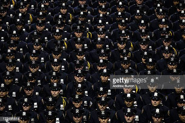 New York City Police Academy cadets attend their graduation ceremony at the Barclays Center on July 2, 2013 in the Brooklyn borough of New York City....