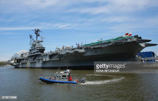 A New York City Police boat patrols the waters near the USS Intrepid a decommissioned World War II aircraftcarrier now the Intrepid Sea Air and Space...