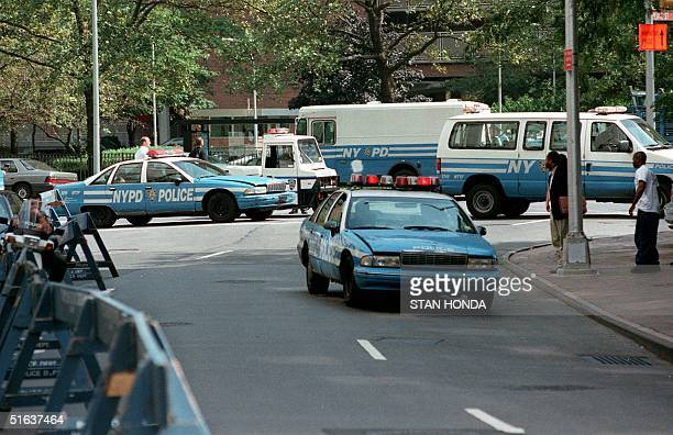 New York City police close the street outside Federal Court 27 August after the arraignment of Mohamed Rashed Daoud Al'Owhali the main suspect in the...