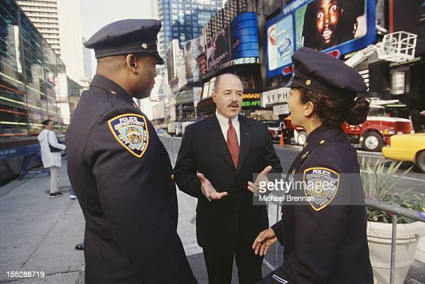 New York City Police Commissioner Bernard Kerik talking to police officers in Times Square, New York City, 2001.