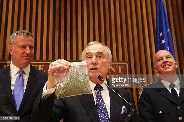 New York City Police Commissioner Bill Bratton holds up a bag of oregano to demonstrate what 25 grams of marijuana looks like at a news conference...