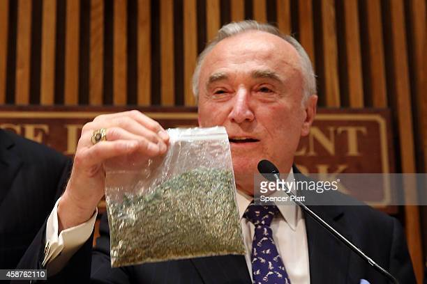 New York City Police Commissioner Bill Bratton holds up a bag of oregano to demonstrate what 25 grams of marijuana looks like at a news conference to...