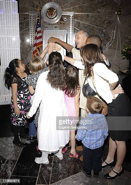 New York City Police Commissioner Raymond Kelly lights the Empire State Building on May 9 2011 in New York City