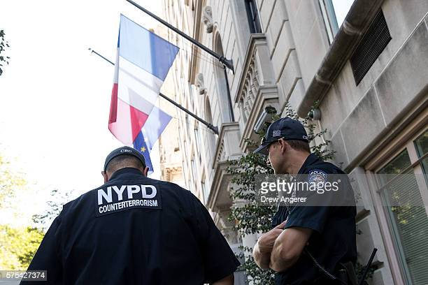 New York City Police Department counterterrorism officers stand guard outside the French Consulate July 15 2016 in New York City Following the...