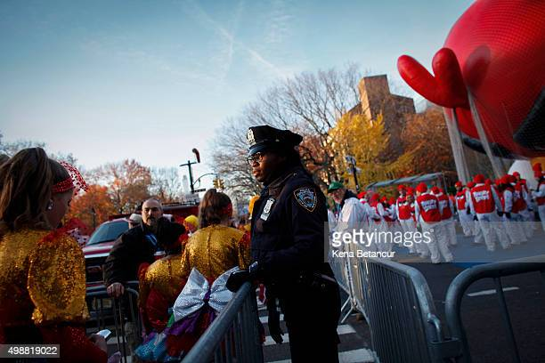 New York City Police department officer stands guard before the annual Thanksgiving Day Parade on November 26 2015 in New York City Security was...