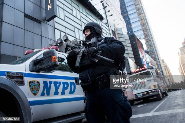 New York City Police Department officer stands guard near the New York Port Authority Bus Terminal December 11 2017 in New York City The Police...