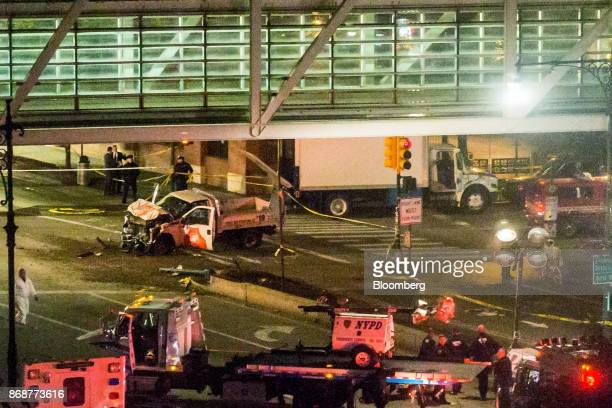 New York City Police Department officers on Chambers Street surround the rented Home Depot Inc pick up truck used in a motorist attack on the West...