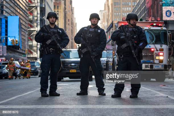 New York City Police Department officers stand guard near the New York Port Authority Bus Terminal December 11 2017 in New York City The Police...