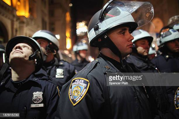 New York City Police face off with Occupy Wall Street protesters after the police in riot gear removed the protesters early today from Zuccotti Park...