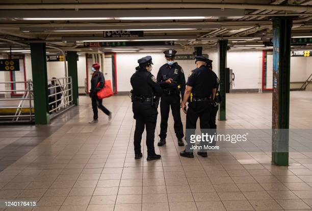 New York City police meet in a virtually empty Union Square subway station in Manhattan on June 01, 2020 in New York City. Amid the coronavirus...