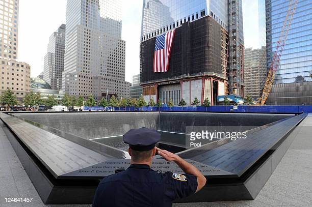 New York City Police Officer Danny Shea, a military vet, salutes at the North pool of the 9/11 Memorial during the tenth anniversary ceremonies of...