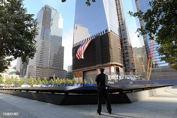 New York City Police Officer Danny Shea a military vet stands at the North pool of the 9/11 Memorial during the tenth anniversary ceremonies of the...