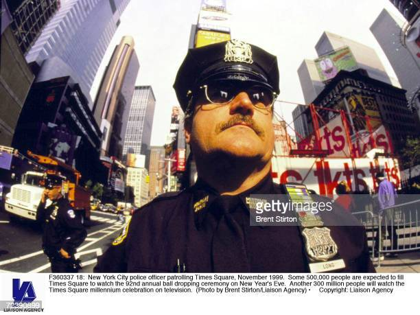 New York City police officer patrolling Times Square November 1999 Some 500000 people are expected to fill Times Square to watch the 92nd annual ball...