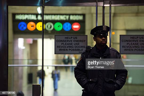 New York City Police officer stands at the entrance to Bellevue Hospital October 23 2014 in New York City After returning to New York City from...