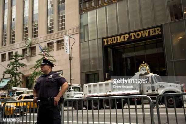 New York City Police Officer stands guard across the street from Trump Tower on Fifth Avenue August 14 2017 in New York City Numerous protests are...