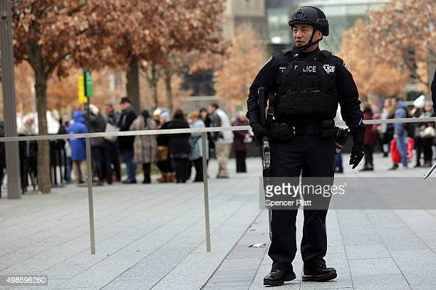 New York City police officer stands guard near One World Trade Center in lower Manhattan on November 24 2015 in New York City Following the terrorist...