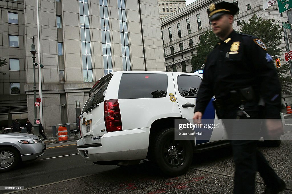 A New York City police officer walks past a Homeland Security vehicle outside of U.S. District Court in Manhattan during a court appearance for three men brought from England to New York to face terrorism charges on October 9, 2012 in New York City. Security was heightened during a hearing for Khaled al-Fawwaz, Adel Abdul Bary and Abu Hamza al-Masri to learn how their cases will proceed to trial. Al-Masri, the one armed Egyptian-born preacher, faces charges that he attempted to set up a terrorist training camp in Oregon and assisted in the abduction of 16 hostages, two of them American tourists, in Yemen in 1998. Both al-Fawwaz and Abdul Bary face charges that they participated in the bombings of embassies in Tanzania and Kenya in August 1998.