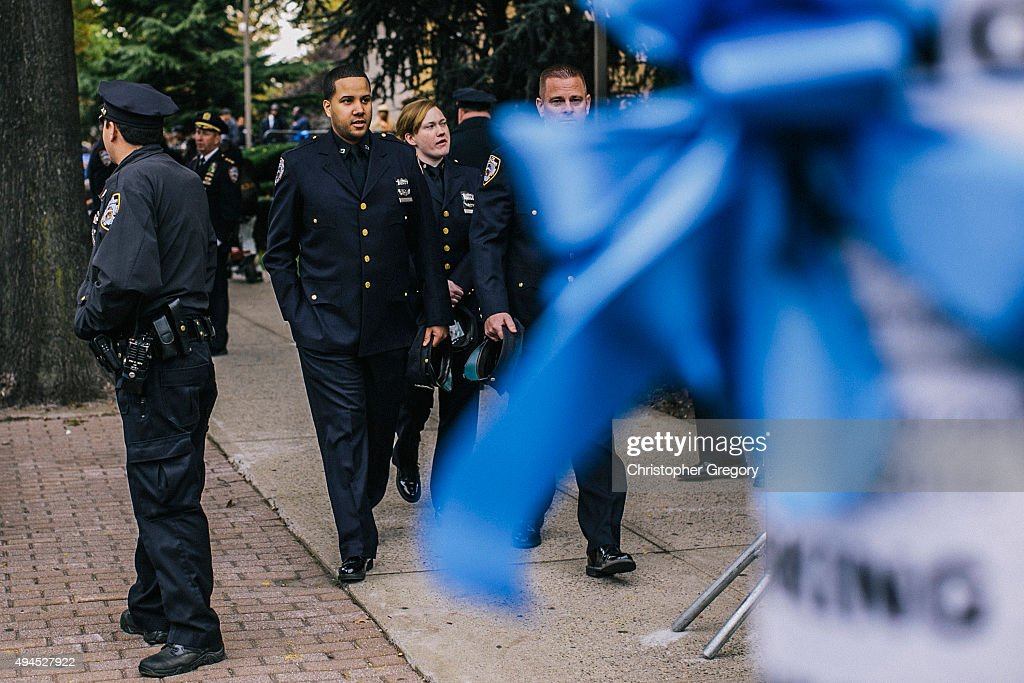 New York City Police officers gather outside the wake of