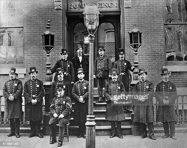 New York City Police officers pose in front of the 20th Precinct Station