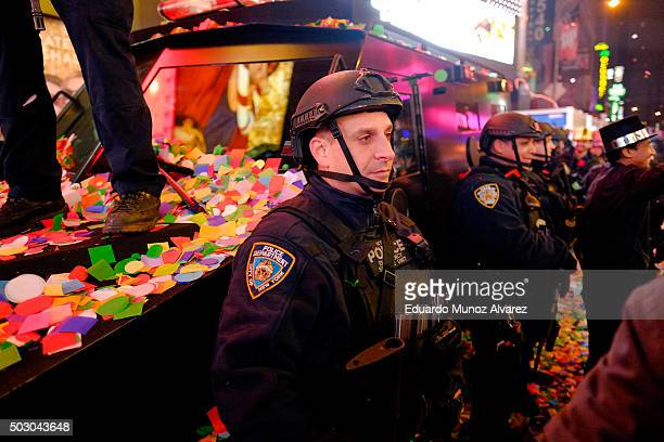 New York City police officers stand during celebrations at Times Square on January 1 2016 in New York City At least 6000 police officers were...
