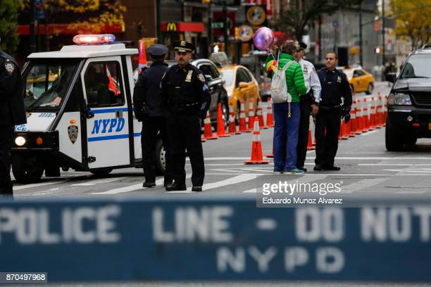 New York City Police officers stand guard before the start of the 2017 TCS New York City Marathon November 5 2017 in New York City NYPD department...