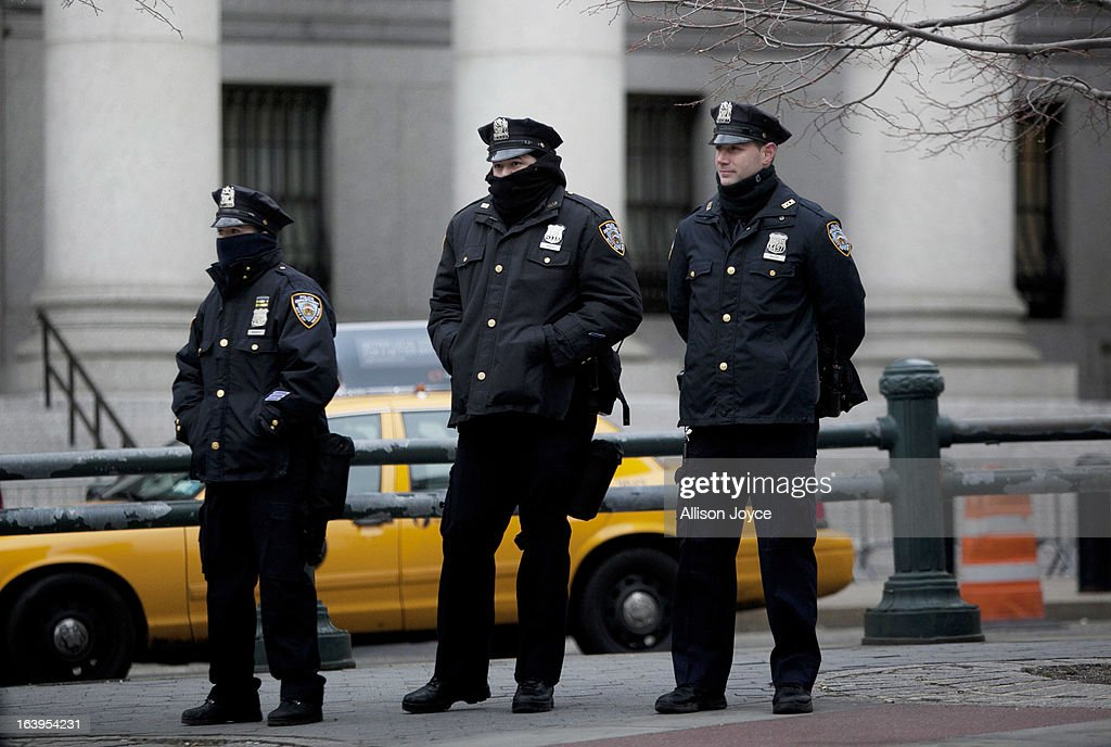 New York CIty Police officers stand near a demonstration against the city's 'stop and frisk' searches in lower Manhattan near Federal Court March 18, 2013 in New York City. Hearings in a federal lawsuit filed by four black men against the city police department's 'stop and frisk' searches starts today in Manhattan Federal Court.