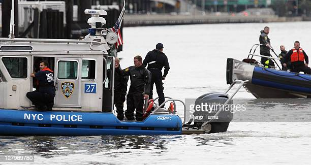 New York City police search the East River after a commericial helicopter crash on October 4 2011 in New York City A helicopter carrying five people...