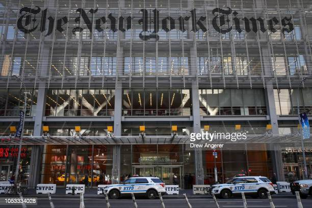 New York City Police vehicles sit parked outside the office of the The New York Times, October 25, 2018 in New York City. Security is being ramped up...