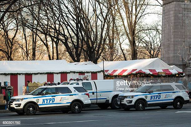 New York City Police vehicles sit parked outside the perimeter of the Columbus Circle Holiday Market December 20 2016 in New York City Following the...