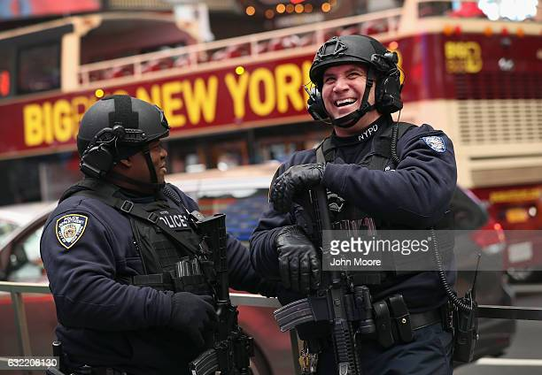 New York City policemen watch the televised inauguration of Donald Trump as the 45th President of the United States while in Times Square on January...