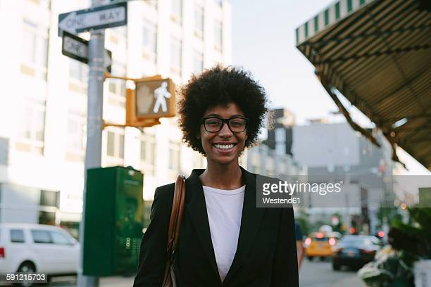 usa, new york city, portrait of smiling businesswoman wearing glasses - black blazer stock pictures, royalty-free photos & images
