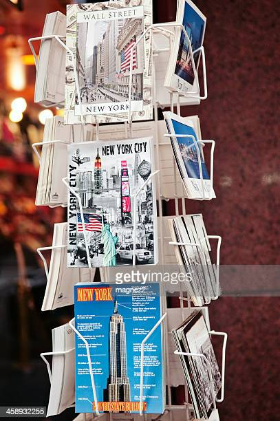 new york city postcards on a rack - magazine rack stock photos and pictures