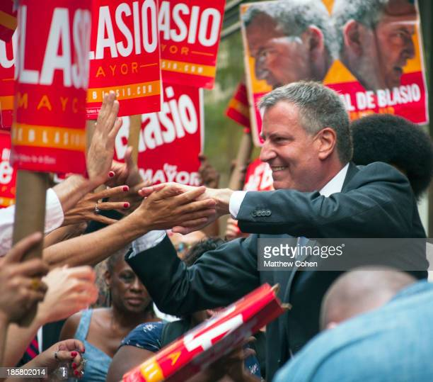 New York City Public Advocate and Mayoral Candidate, Bill de Blasio , greets voters before heading into the studios at Rockefeller Center. De Blasio...