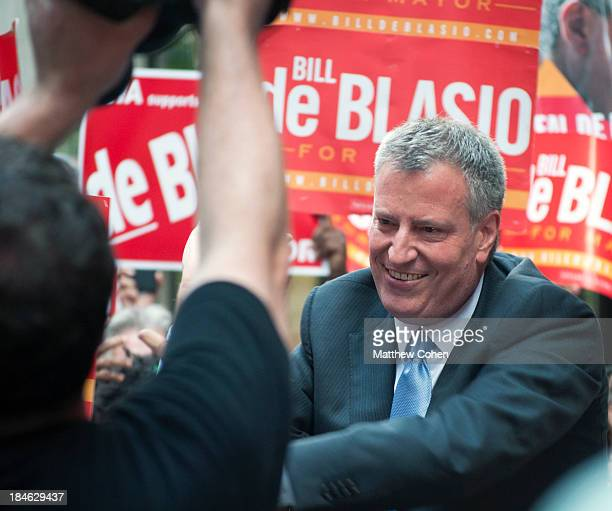 New York City Public Advocate, and Mayoral Candidate frontrunner Bill de Blasio , greets voters at Rockefeller Center before the final televised...