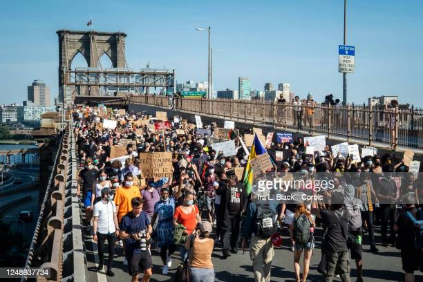 New York City Public Advocate Jumaane D. Williams leads a crowd of thousands in a sllent protest walk across the Brooklyn Bridge. This was on the day...