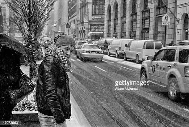 New York City resident feeling under-dressed in one of the worst snow blizzards in NYC in the last couple of years Leica M3, 50mm summilux...
