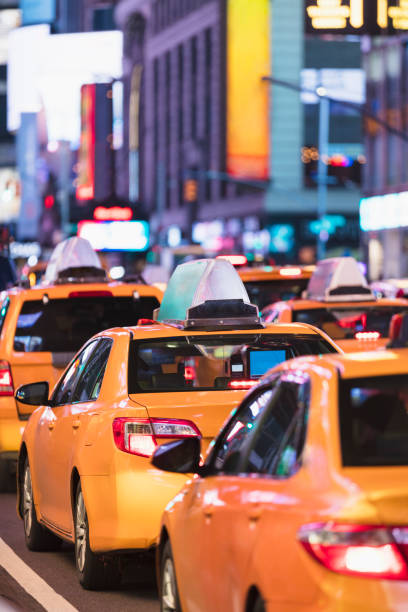 USA, NY, New York City, Row of yellow cabs in Times Square