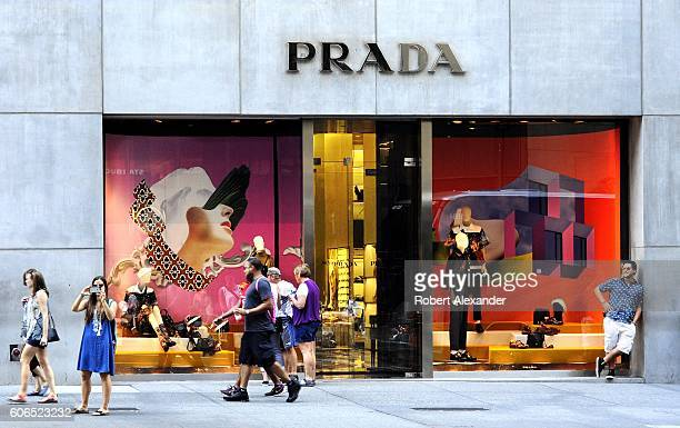 August 27, 2016: New York City shoppers and visitors walk past the Fifth Avenue entrance to the Prada store on 2016.