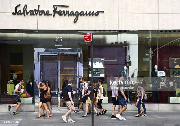 August 27, 2016: New York City shoppers and visitors walk past the Salvatore Ferragamo store on Fifth Avenue on August 27, 2016. The Italian luxury...