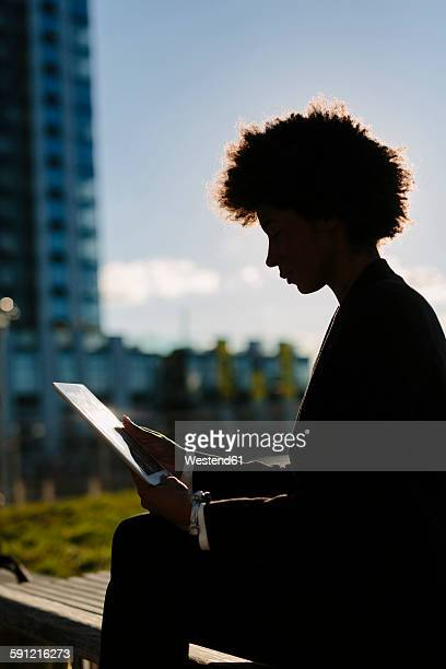 usa, new york city, silhouette of businesswoman looking at digital tablet - high contrast stock pictures, royalty-free photos & images